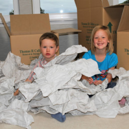 Children in boxes and prized possessions